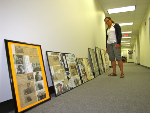 Amy Sheppard, supervisor of NewBridge Jobs Plus, looks at framed photos waiting to be hung in the new building.