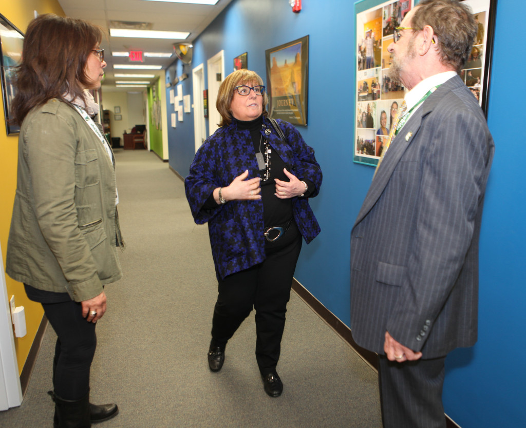 Morris County Freeholder Director Kathy DeFillippo (center) gets a tour of the NewBridge Parsippany Center from Amy Sheppard (left)  and CEO Robert Parker. The staff of NewBridge welcomed local business leaders, government leaders and members of the public to the grand opening of NewBridge Parsippany Center. The 15,320 square-foot-center provides mental health counseling, educational services, addiction treatment and wellness programs for the community.
