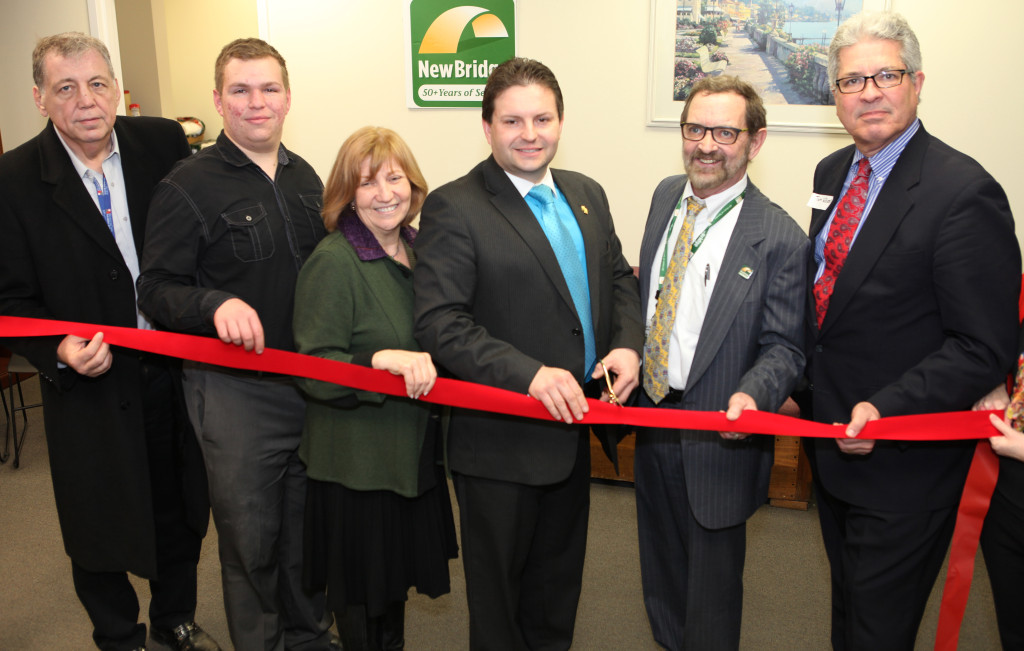 (left to right) Frank Cahill of the Parsippany Area Chamber of Commerce, Nicolas Limanov, of the Chamber of Commerce, Eva Turbiner,of Zufall Health, Robert J. Peluso, of the Parsippany-Troy Hills Council, NewBridge CEO Robert Parker, and Tom Williams cut the ceremonial ribbon at NewBridge. The staff of NewBridge welcomed local business leaders, government leaders and members of the public to the grand opening of NewBridge Parsippany Center. The 15,320 square-foot-center provides mental health counseling, educational services, addiction treatment and wellness programs for the community.