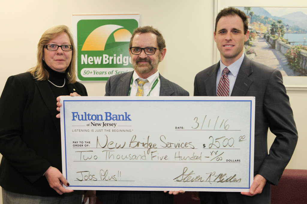 Janice Christensen (left) and Keith German, both of Fulton Bank of NJ, present a check to NewBridge CEO Robert Parker. The staff of NewBridge welcomed local business leaders, government leaders and members of the public to the grand opening of NewBridge Parsippany Center. The 15,320 square-foot-center provides mental health counseling, educational services, addiction treatment and wellness programs for the community.