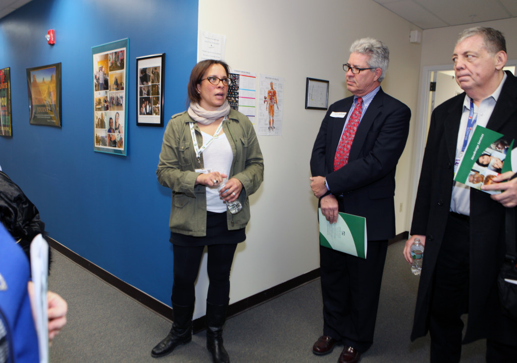 Amy Shepard (center) gives a tour of the newly opened NewBridge Parsippany Center. The 15,320 square-foot-center provides mental health counseling, educational services, addiction treatment and wellness programs for the community.
