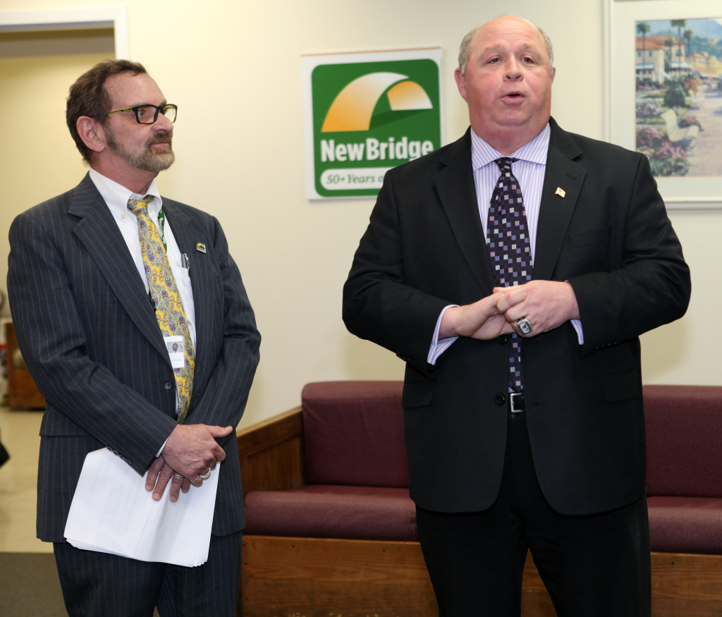 Robert Parker listens as Parsippany Mayor James R. Barberio speaks at  the grand opening of NewBridge Parsippany Center. The 15,320 square-foot-center provides mental health counseling, educational services, addiction treatment and wellness programs for the community.