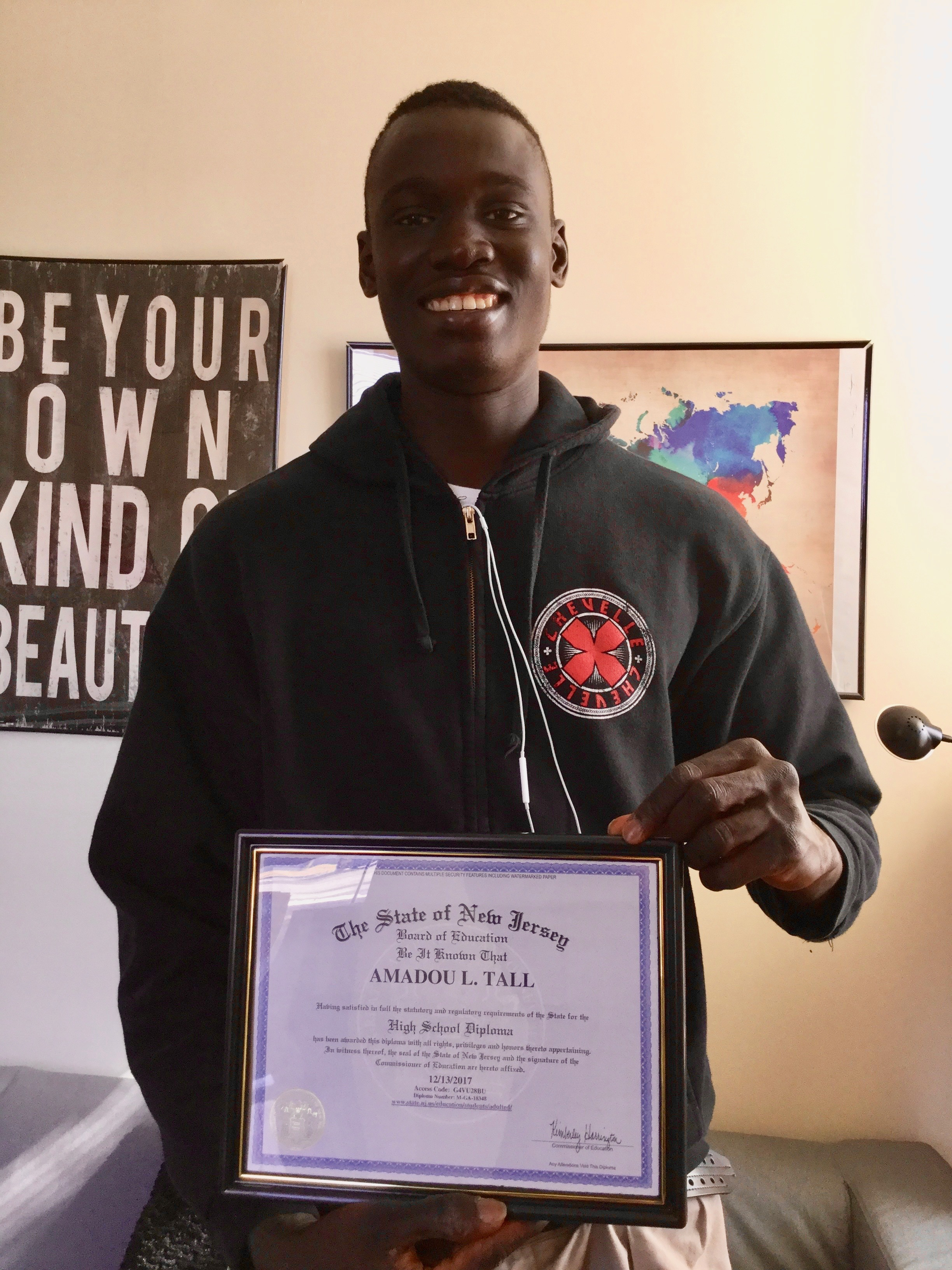 Amadou Tall persevered to earn his New Jersey high school diploma in 2017.
