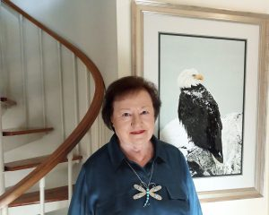 Photo of Isabel Wayrick with her painting of a bald eagle.