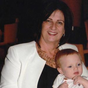Kathy Eberly Ovitt with her grandchild
