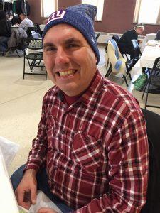 NewBridge client Steven Henry smiling .