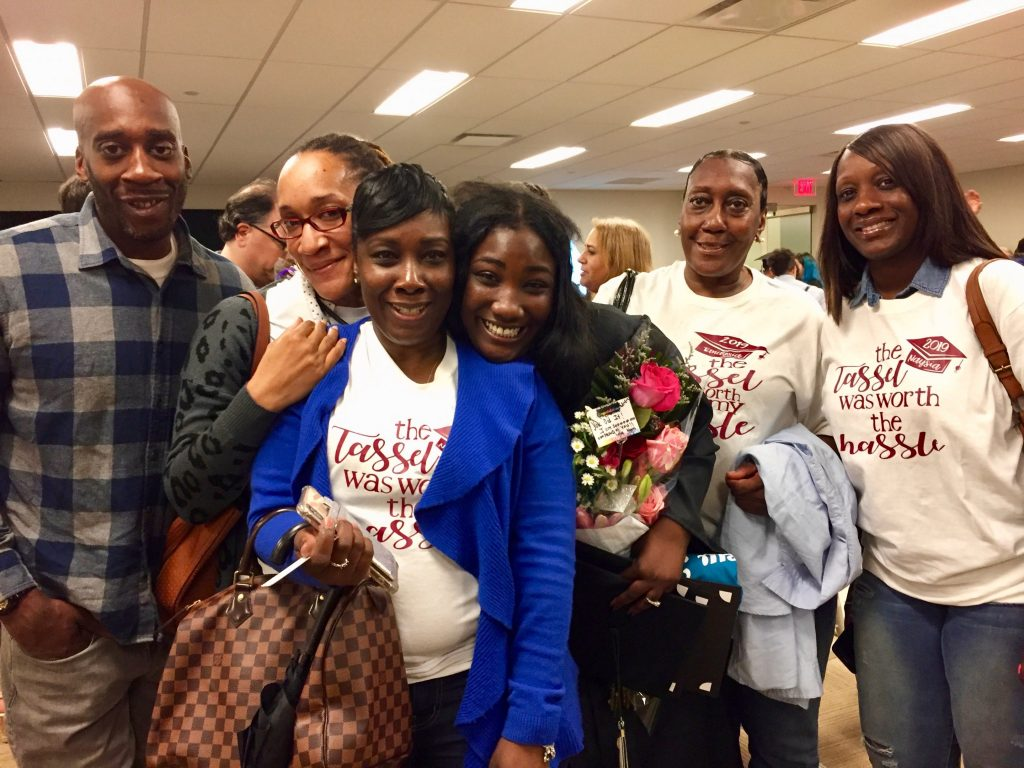 NewBridge Jobs Plus graduate Tanaysia Smith, center, surrounded by her uncle, Jameel Smith, aunt Rahseeda Smith, mother Lakesha Smith, grandma Annie Smith, and cousin Ayanna Haneiph.