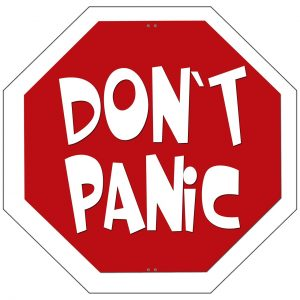 a stop sign that says Don't Panic