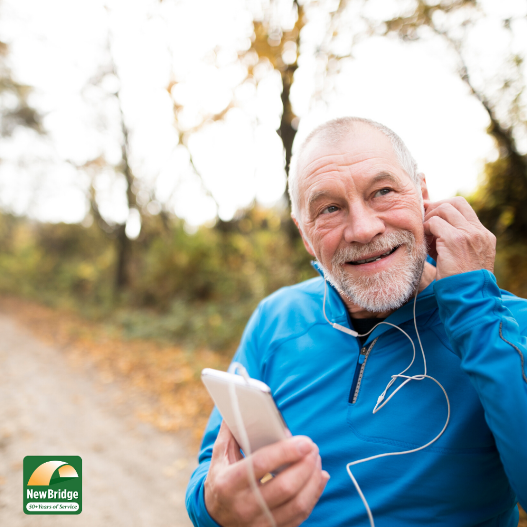 Older adult listening to his iPhone